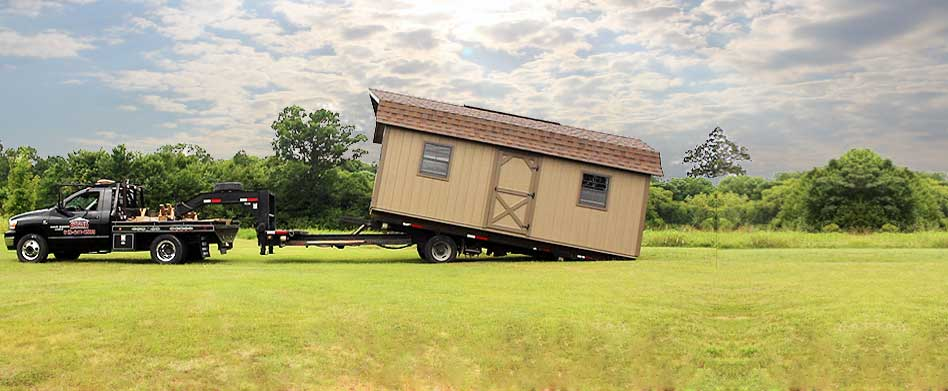 Safely Slip A Storage Building Softly Into Place.